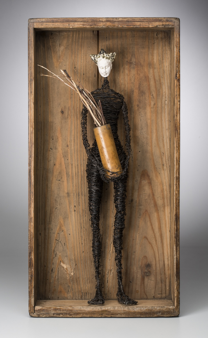 Figure in Box with Twigs