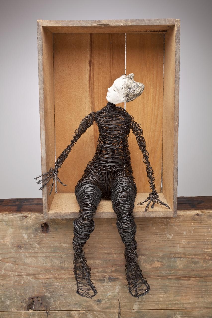 Seated Peering Figure