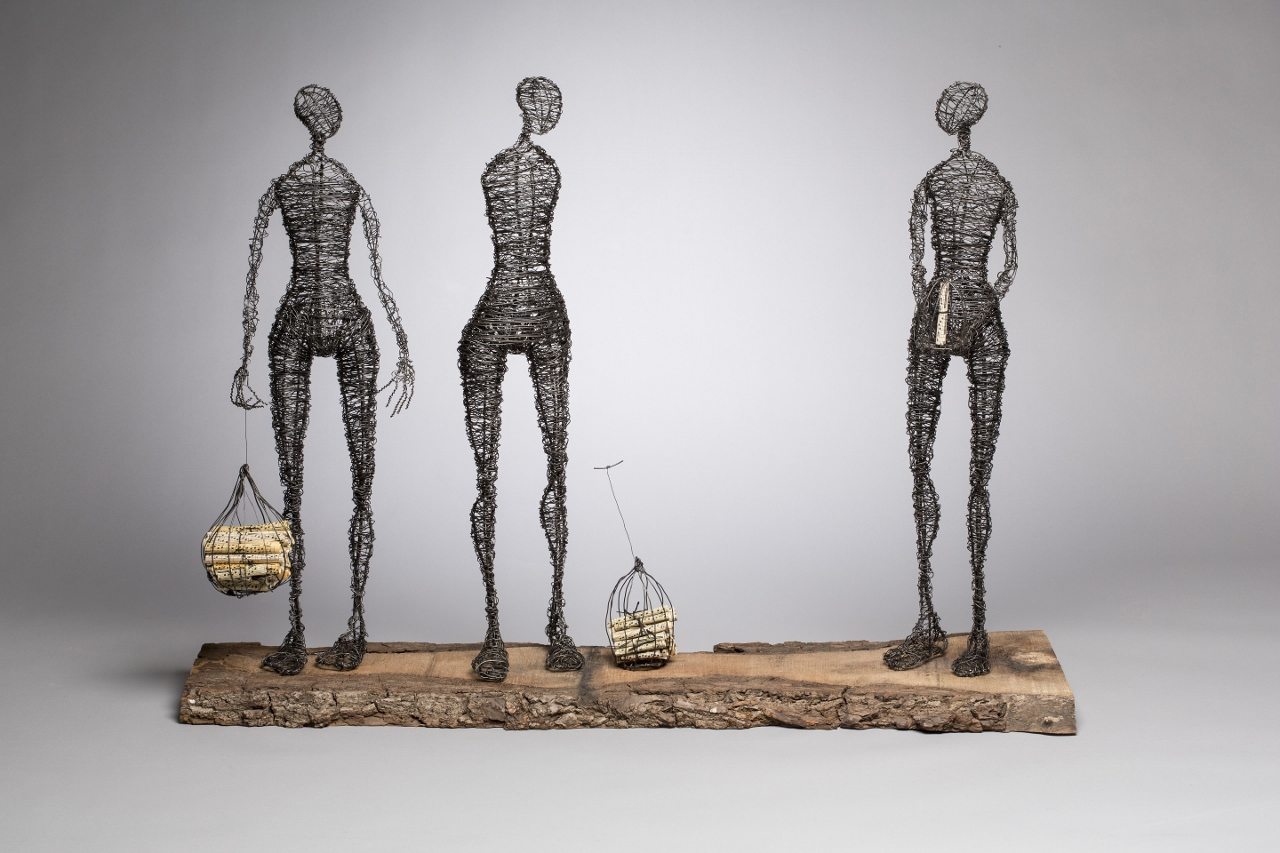 Three Figures with Music Cages