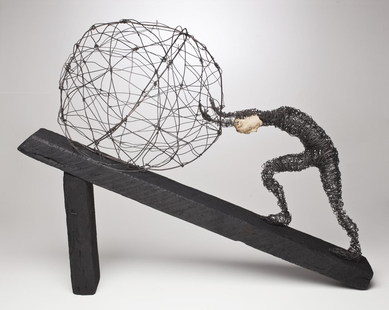 Figure Pushing Ball Uphill