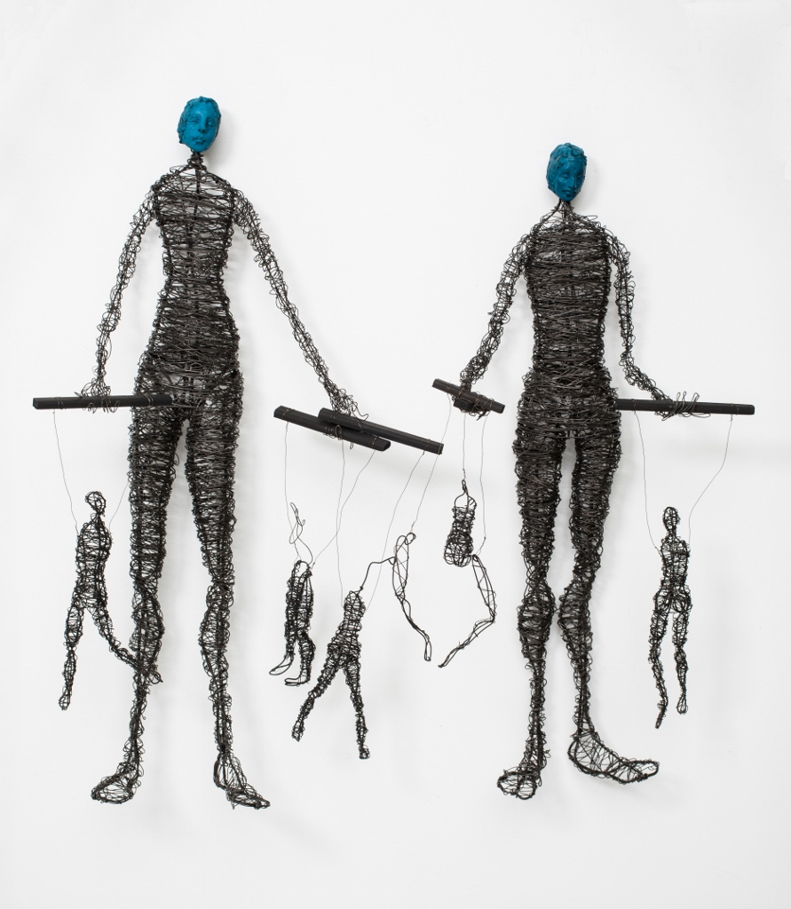 Two Figures with Marionettes