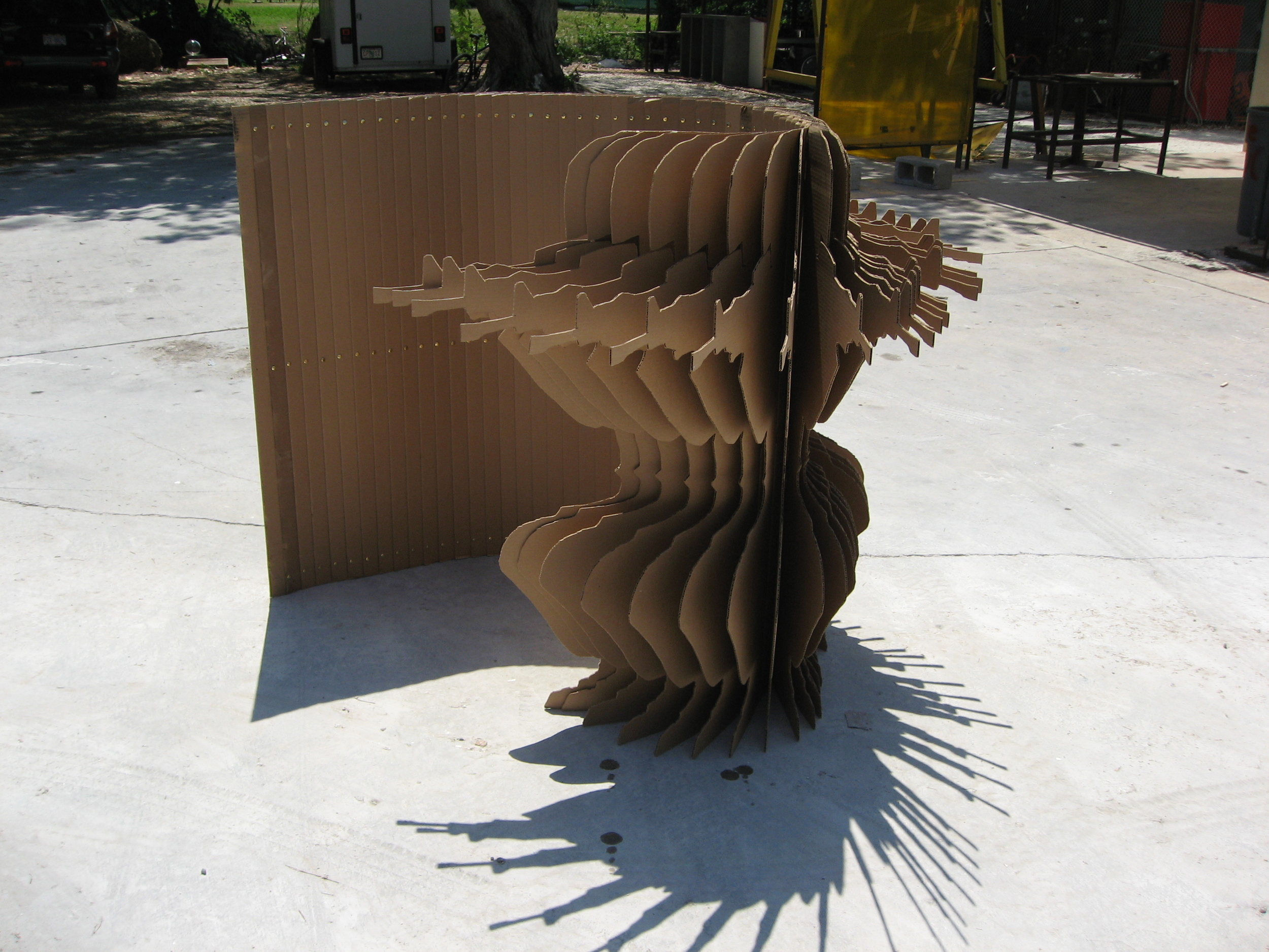 The Other Side, 2007, cardboard, brass, dimensions variable; as pictured 60%22x60%22x48%22 .JPG