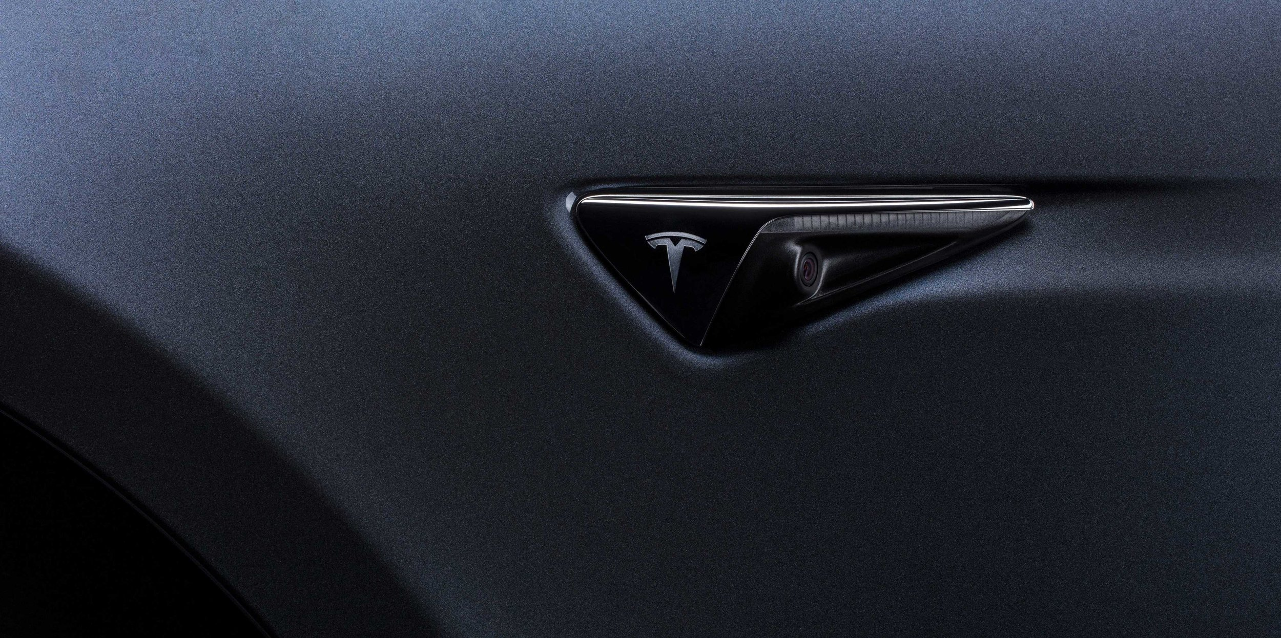 TESLA-CAR-CAMERA-BADGE-UPDATE-2019.jpg