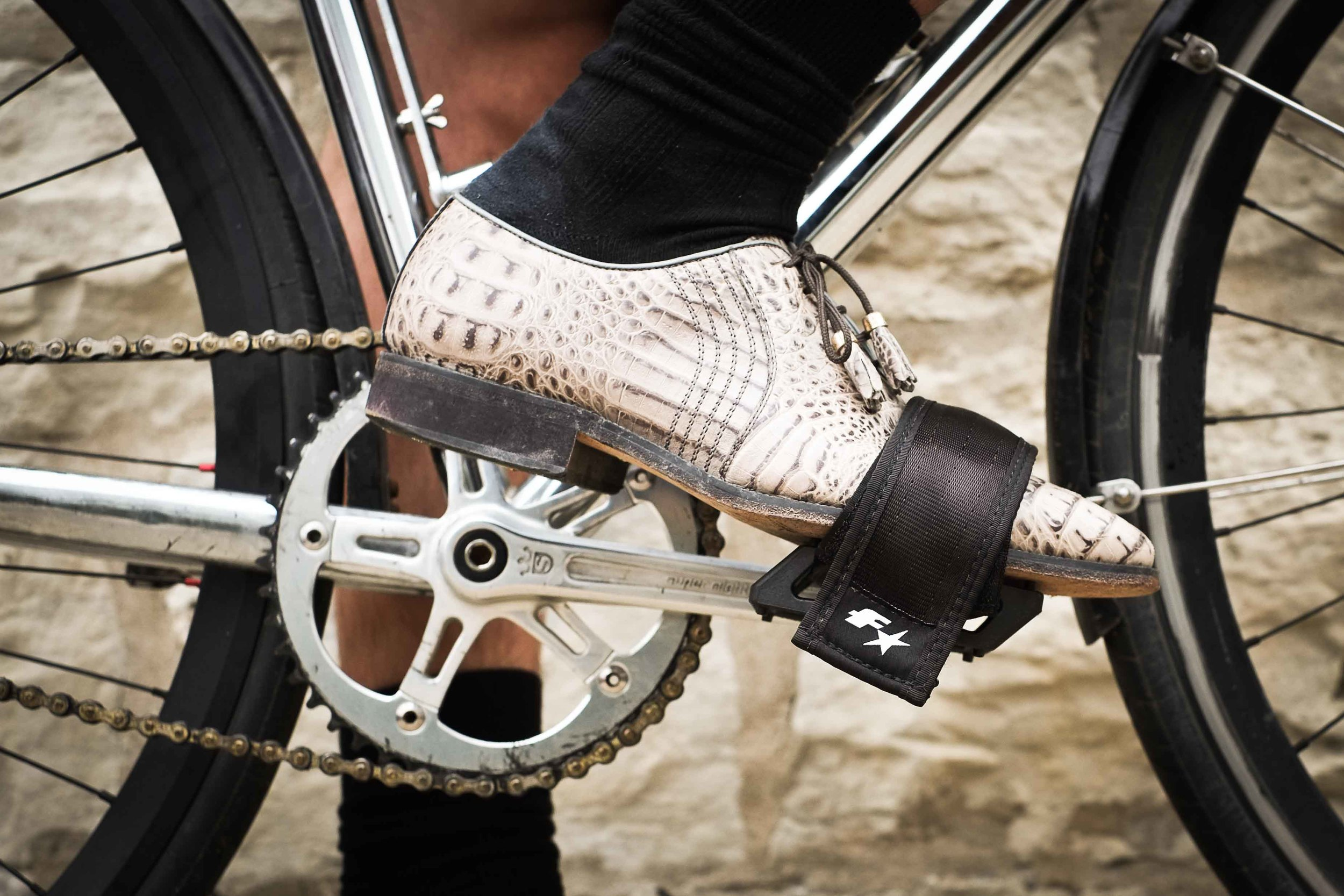 Almost as efficient as clipless pedals, but you don't have to trade in your crocodile leather for plastic and nylon.