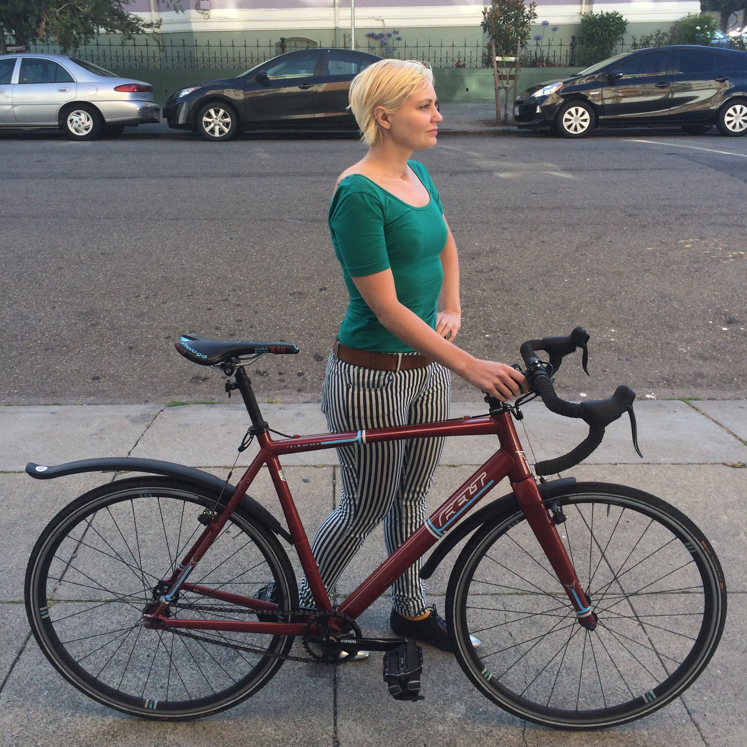 Stand with your bike on your right and position yourself about halfway between the seat and the handlebars. You will be standing on the opposite side of the chain which will help prevent accidentally greasing up your snazzy new fashion pants.