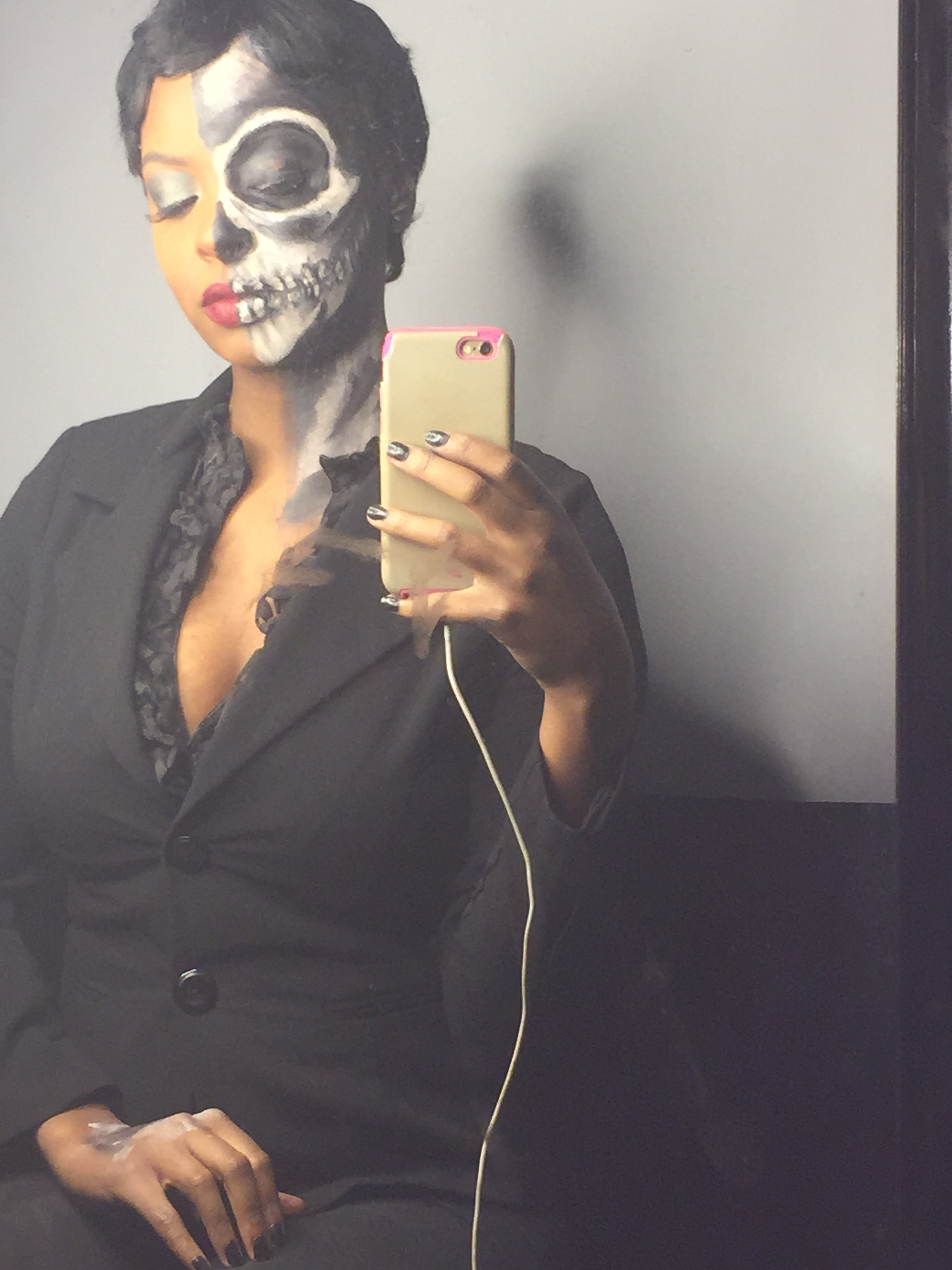 1. First up -  Beyonce ! You can either choose one of your favorite Beyonce looks and recreate it or add a twist and create a half skull look. The half skull look will give you a spooky halloween vibe.