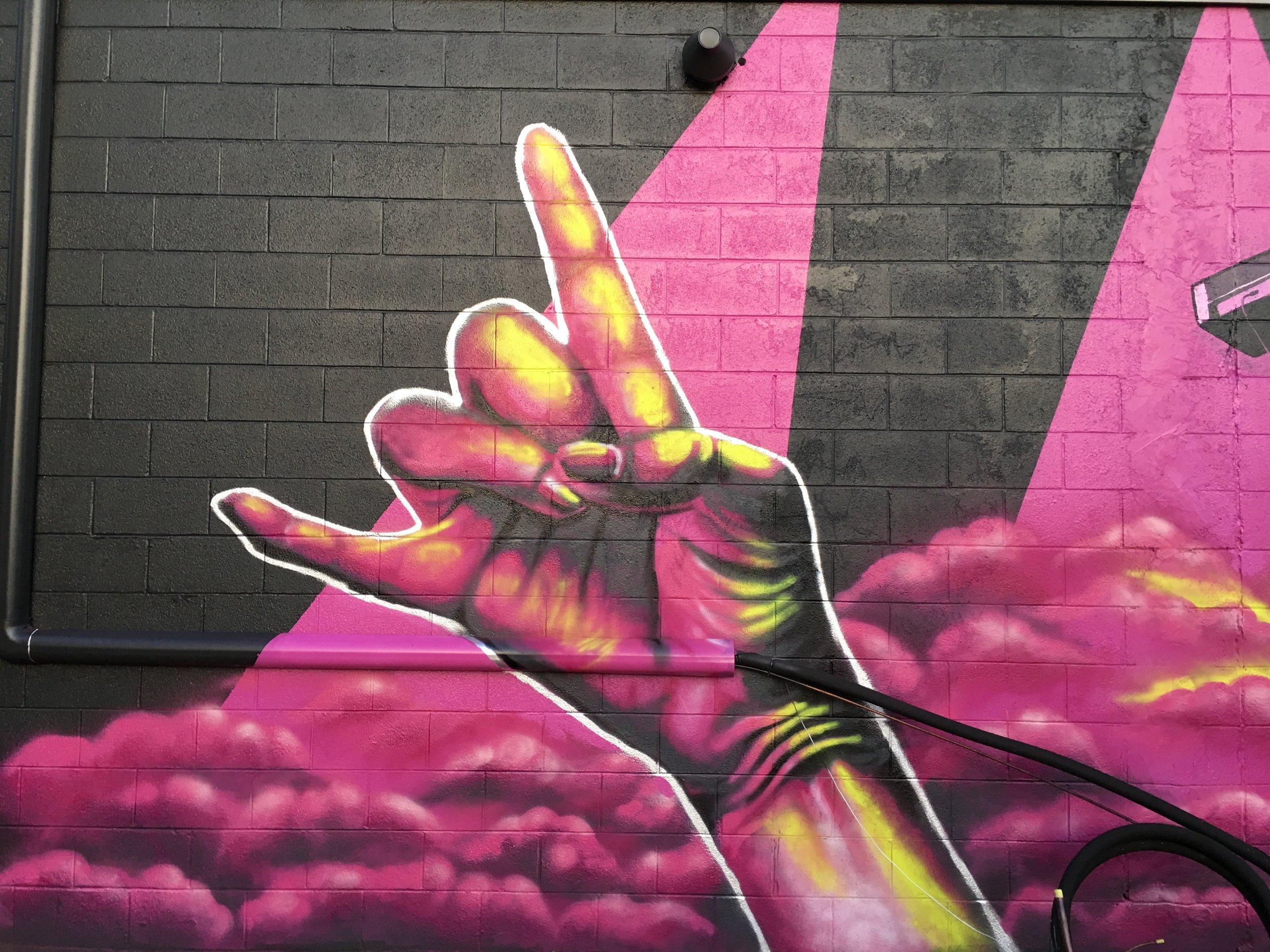 Spray painted hand with purple smoke