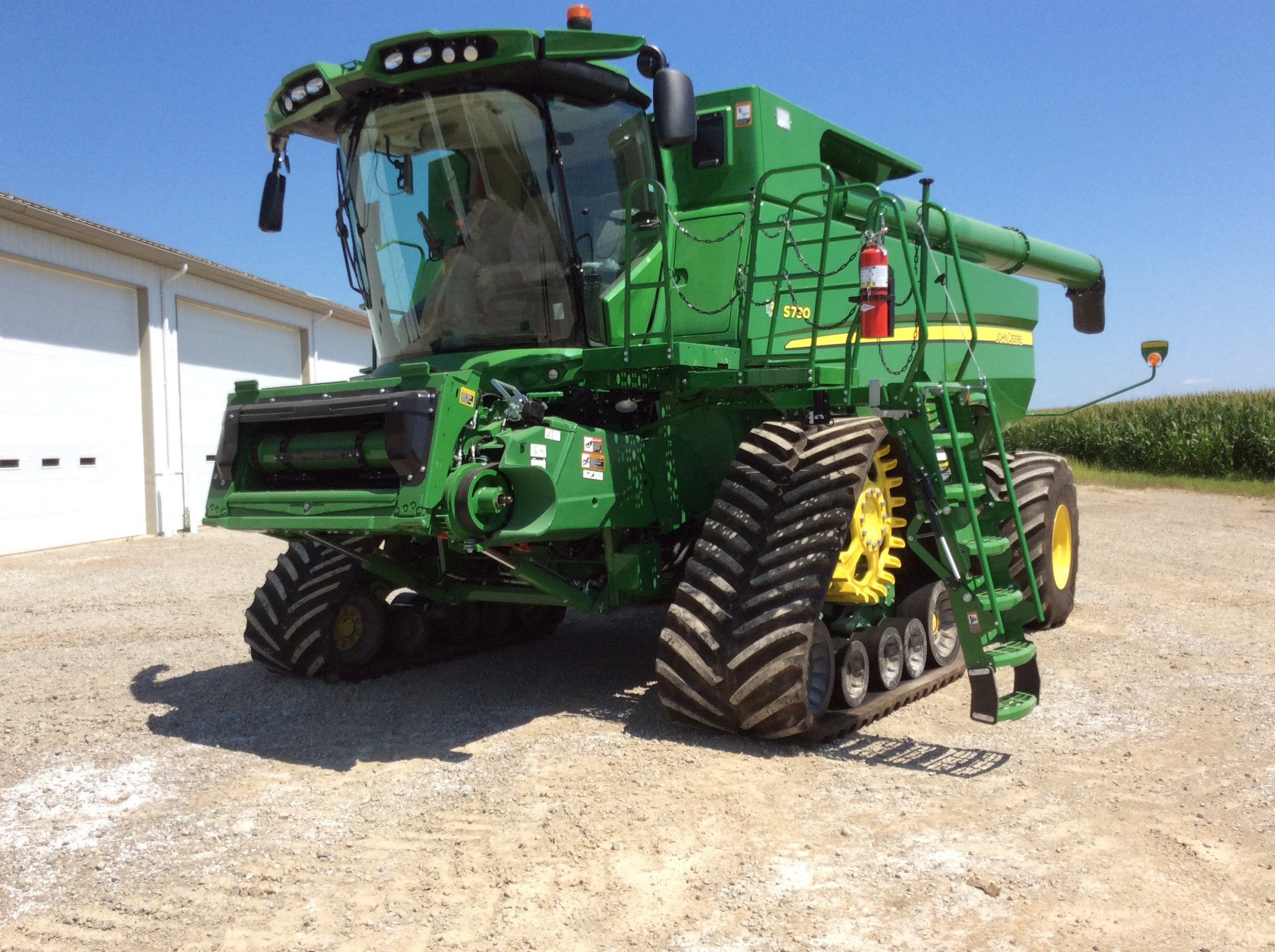 Pictured above is a new 2019 John Deere S790 combine with factory tracks and folding ladder. PWR EZ SYSTEMS has been asked to create a power fold for the steps and a power swing for the entire cab entry platform. Each function can be operated separately or together at the same time. They can also be stopped at any time with the push of a button.