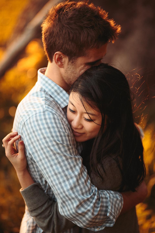Hugging-on-lovers-lane-san-francisco-engagement-photo