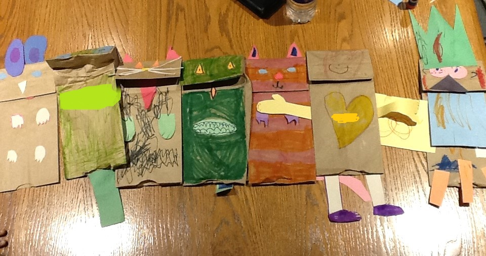 The kindergarteners' completed paper bag puppets