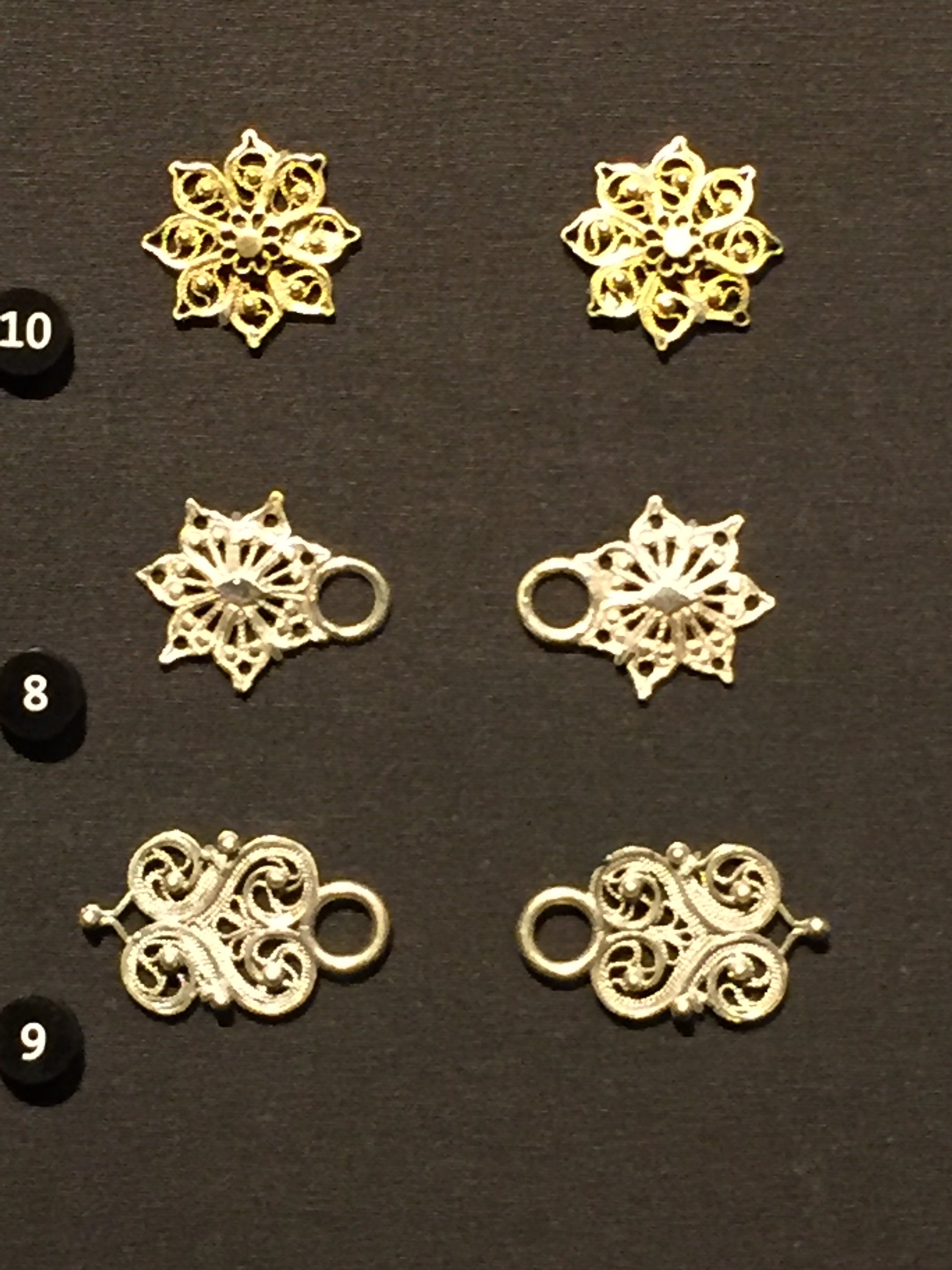 # 10 Appliques 1800-1900. #8 &9 Bodice fasteners 1800-1900. Photo taken by Aleks Byrd at Victoria Albert Museum