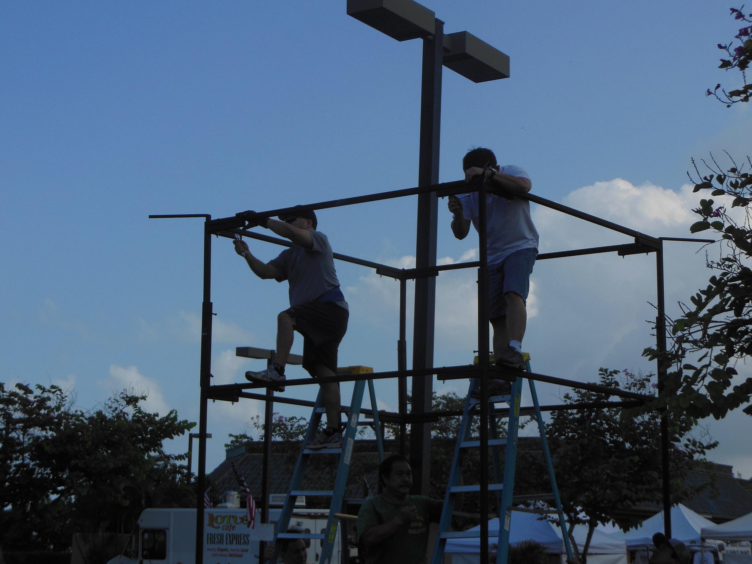 Members of the Kona Hongwanji Shinwakai help put together the yagura.