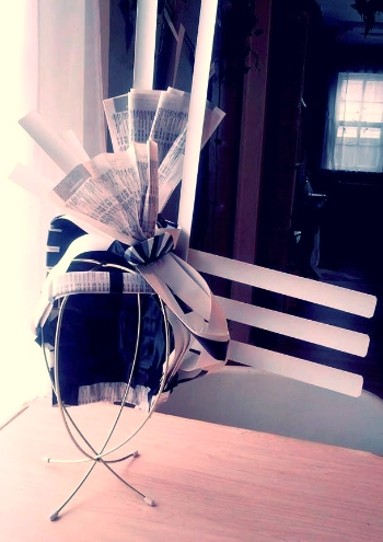 Window blinds, newspaper & eraser hat by Jill Rust