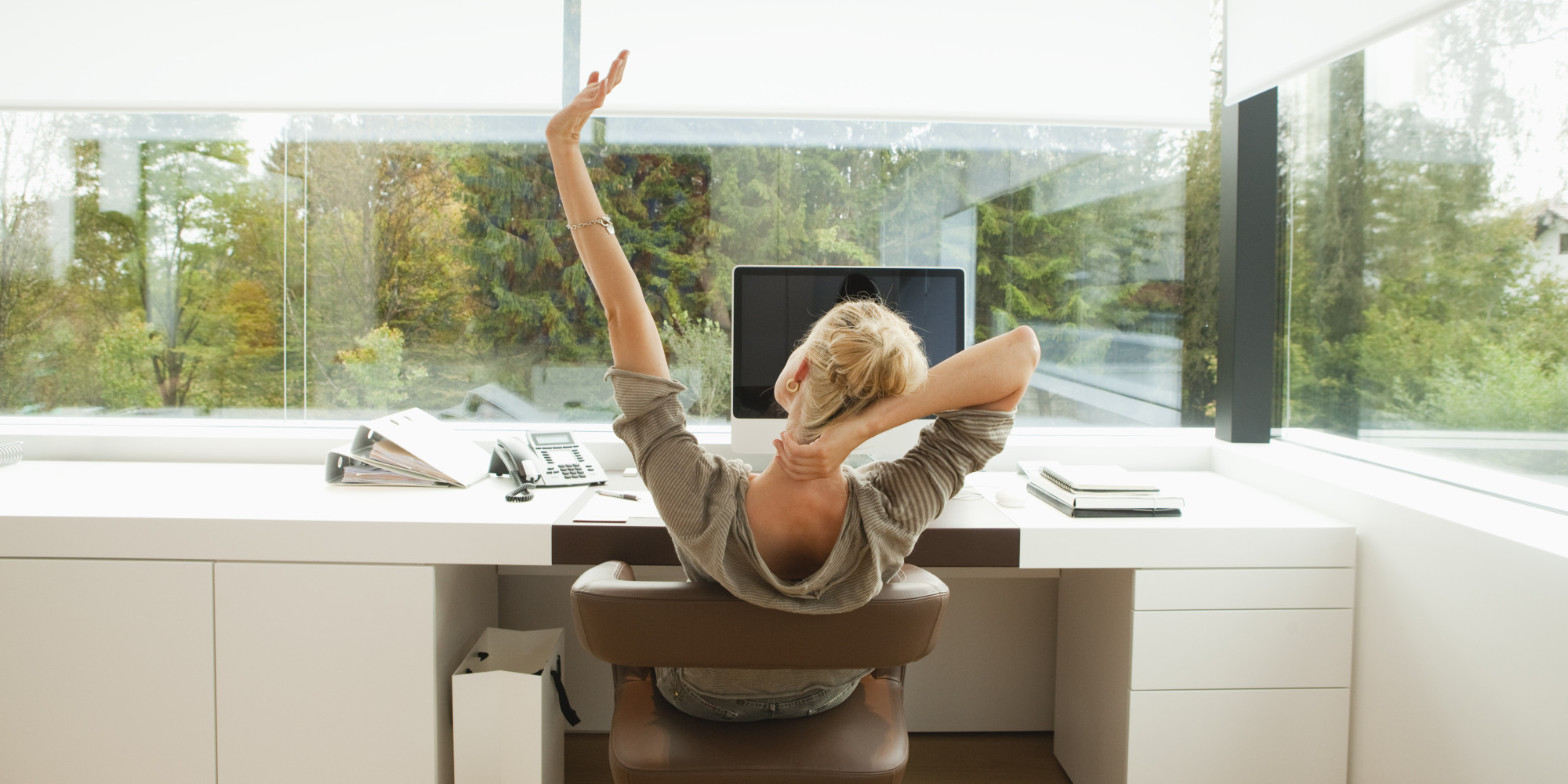 Woman with back pain at computer.jpg.838x0_q67_crop-smart.jpg