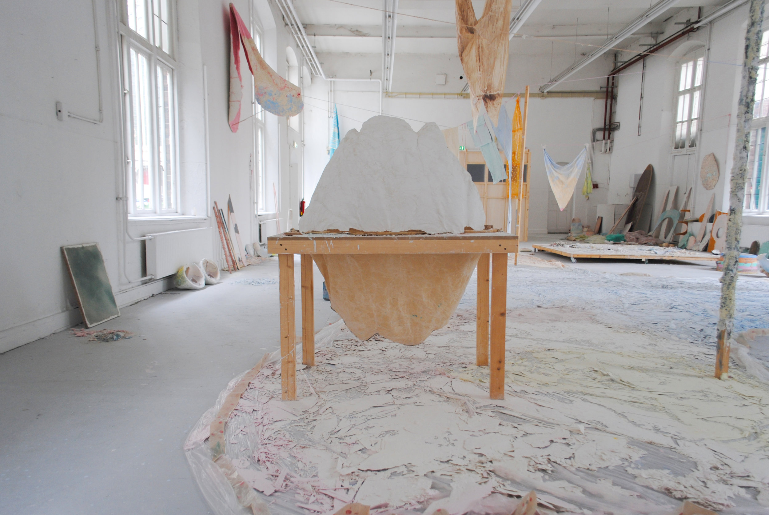 Detail: Molding table, Some things that still need to be said (also about how candy is made) - Colored chalk, textiles, wax, plastics, various paints, wood, 2400 x 1100 cm, graduation show