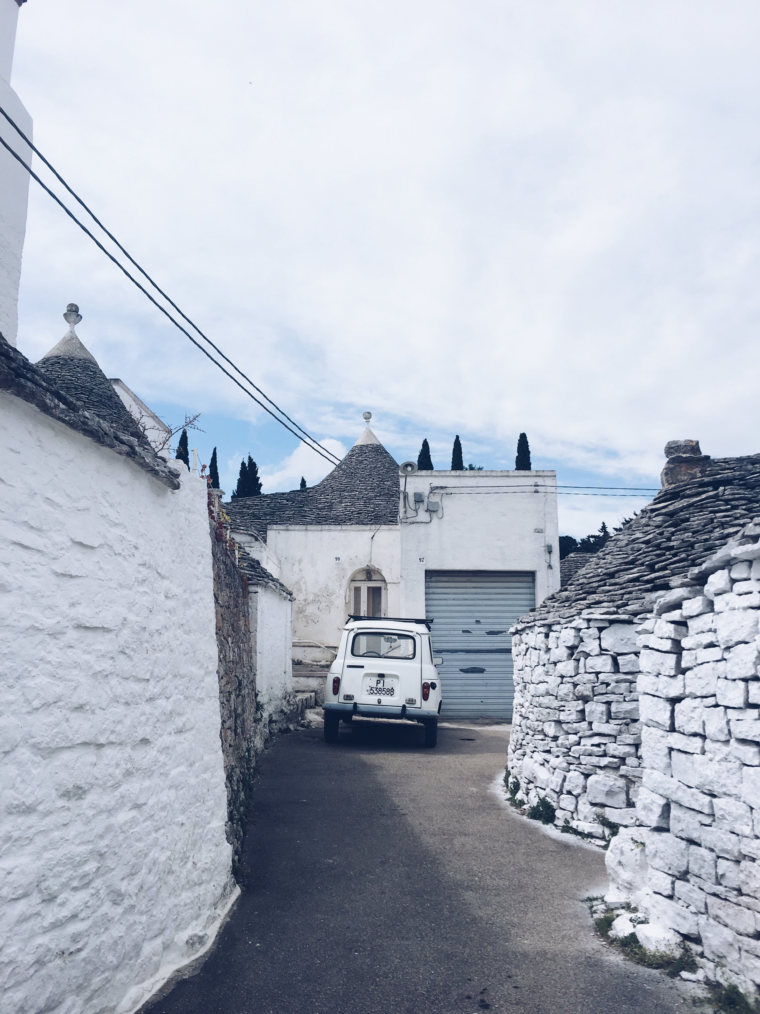 Cutest Trulli (traditional houses) & an old Renault in Arbelobello