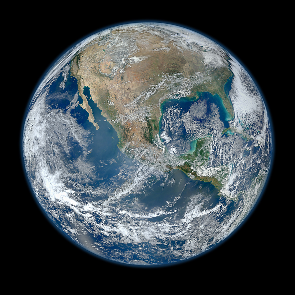 "NASA's composite image of the western hemisphere titled ""Blue Marble 2012."" This photo is an updated version of the original Blue Marble photograph of the Earth taken by Apollo astronauts in 1972."