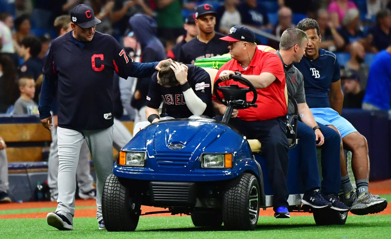 Tyler Naquin being carted off Rays Field after collision.