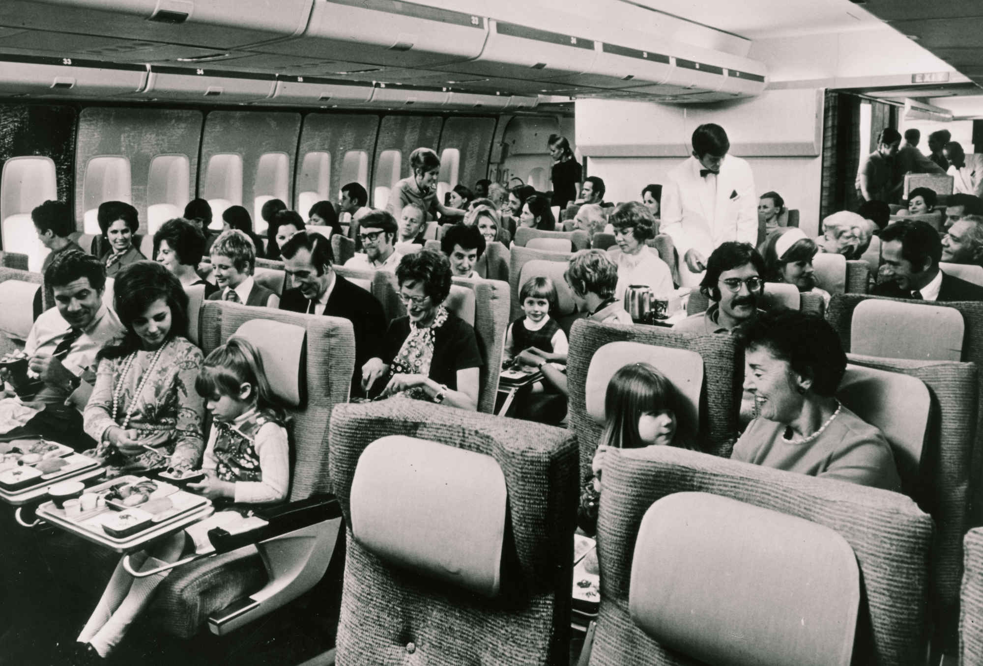 From a time when people traveled with less luggage—note the overhead bins. (image credit:  NPR , via SuperCompressor)