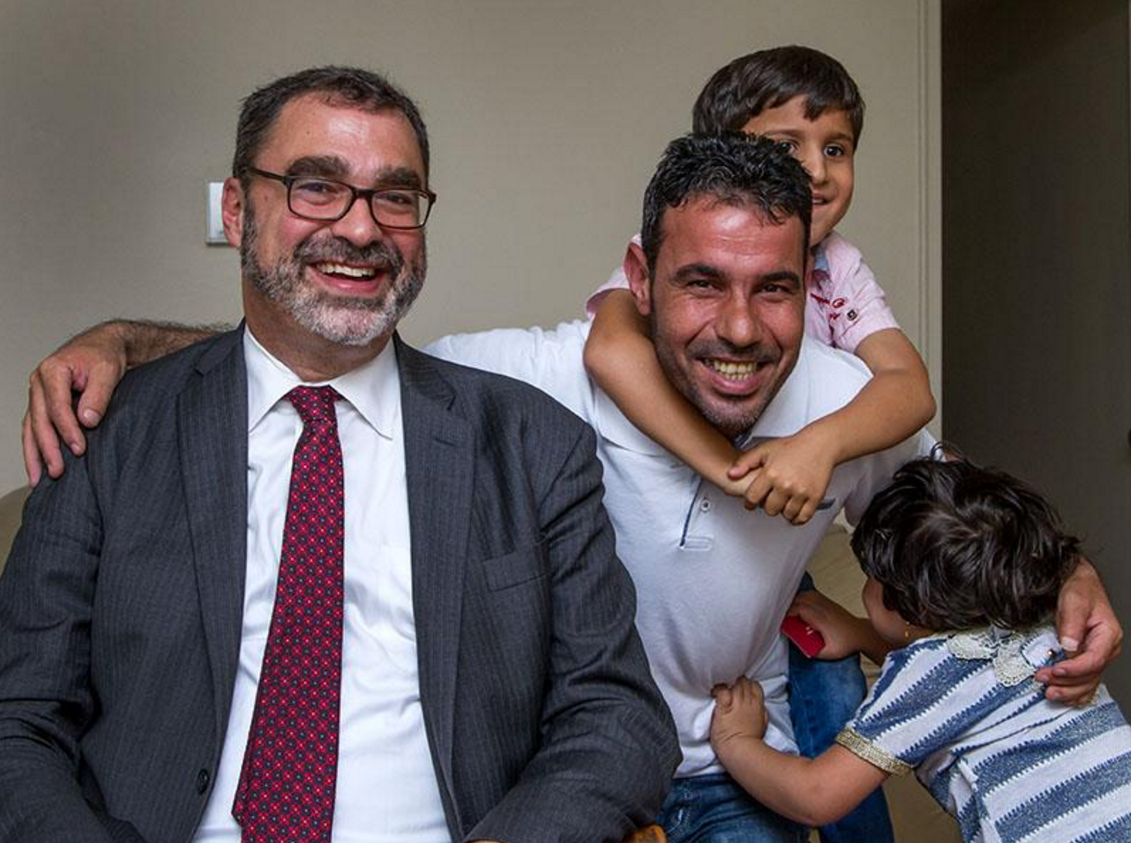 Mark Hetfield with resettled Syrian refugee Omar and his children during a visit with resettled Syrian families in Toledo, Ohio. Photo Christie Materni