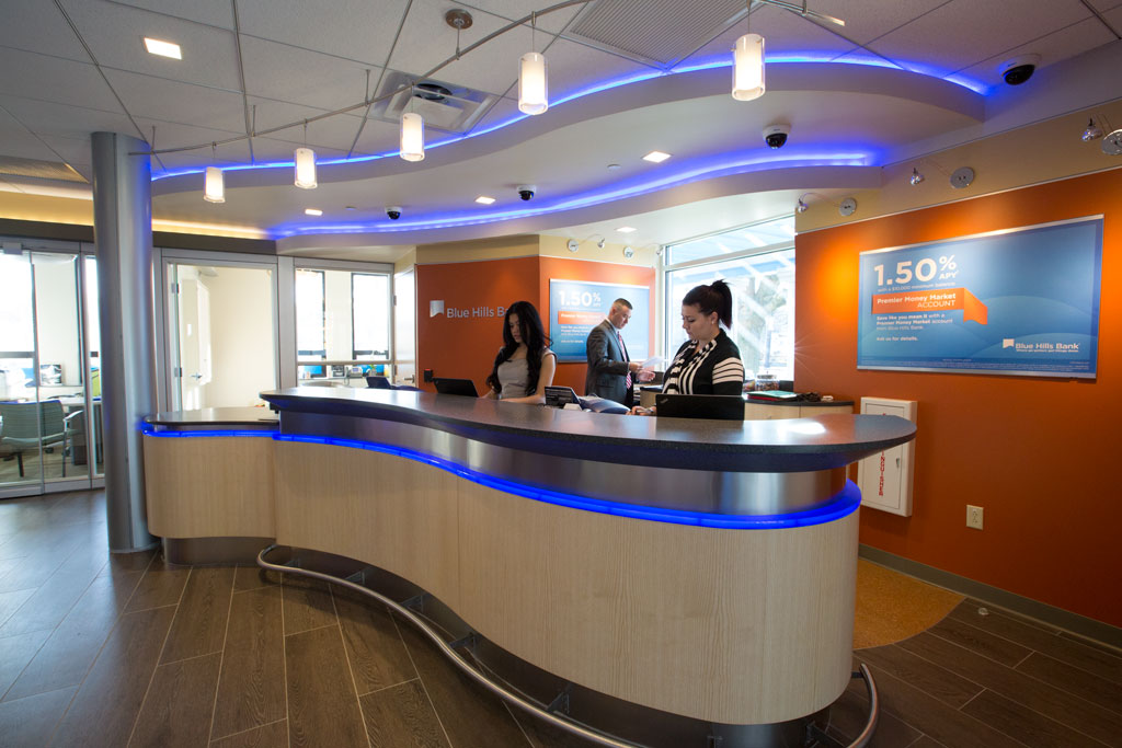 Interior view from branch entrance featuring a custom serpentine teller-bar, designed by Brian Judd.
