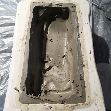 the original being removed from the mold