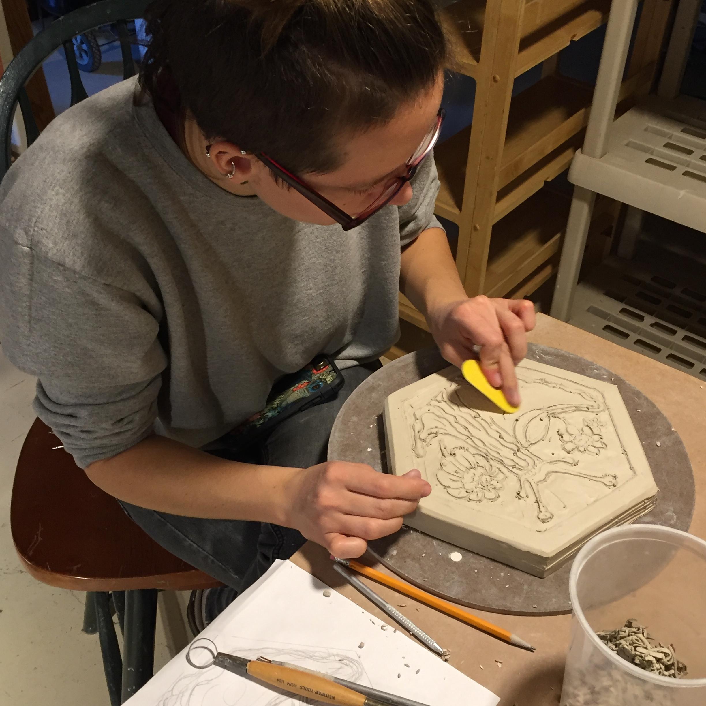 Jordan carving her slug tile