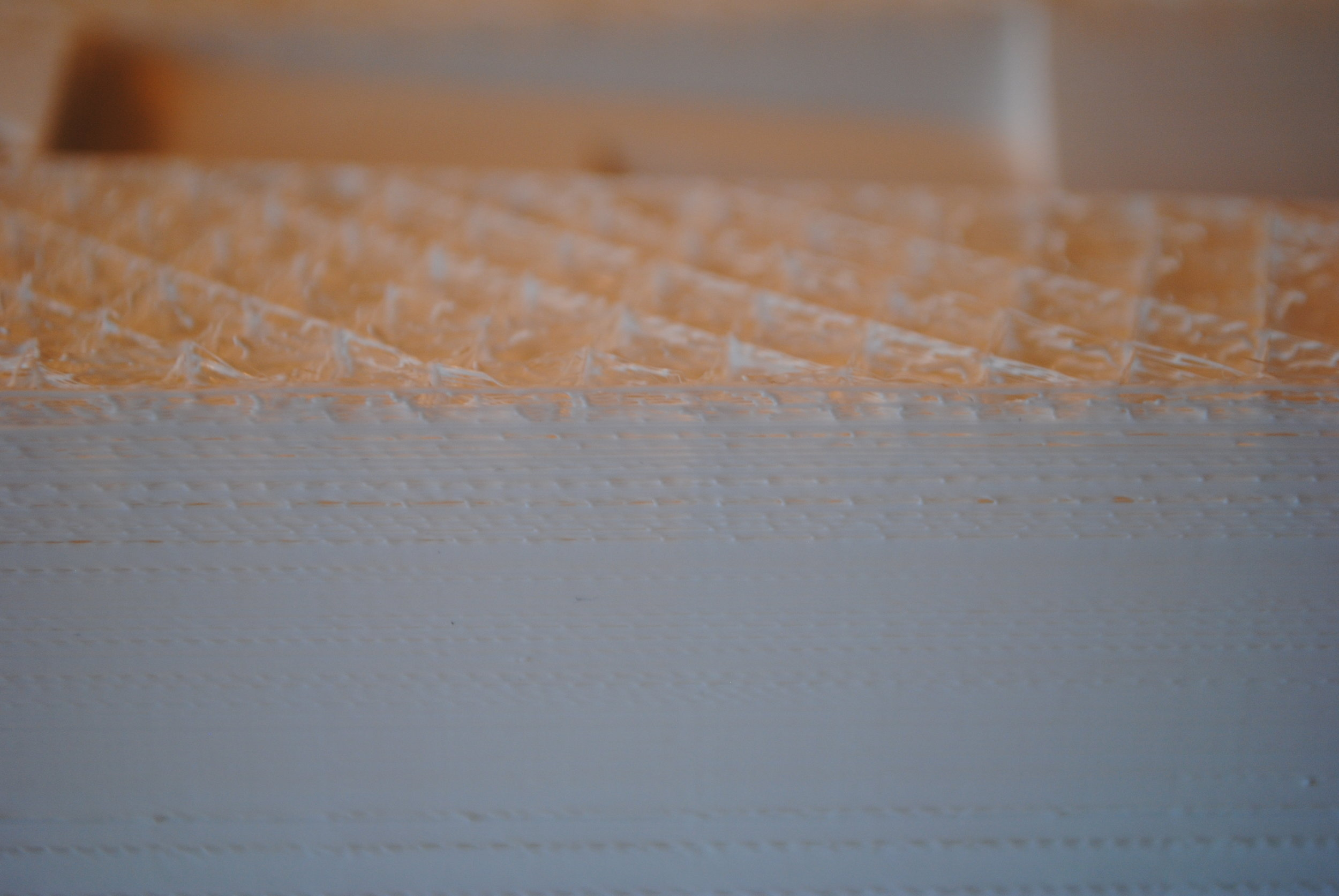 Example of layer separation and poor adhesion of printing medium