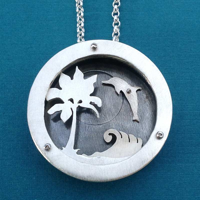 Extra large four layer shadowbox necklace with spinning dolphin.