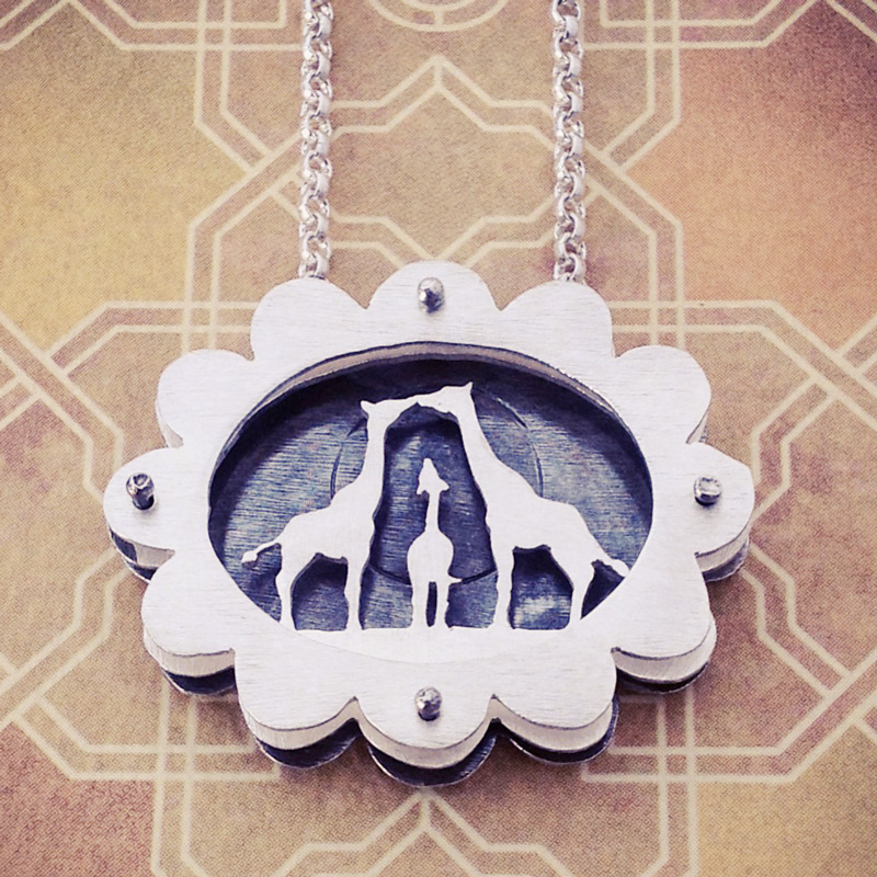 Large scalloped shadowbox necklace with giraffe family for expecting mother-to-be.