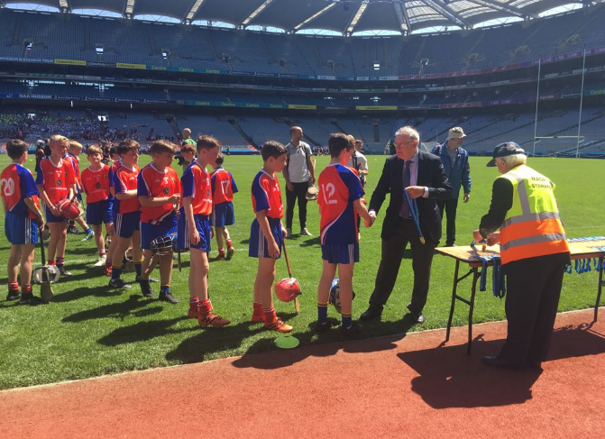 Belgrove players Jack, Paddy & Rory collecting their medals.