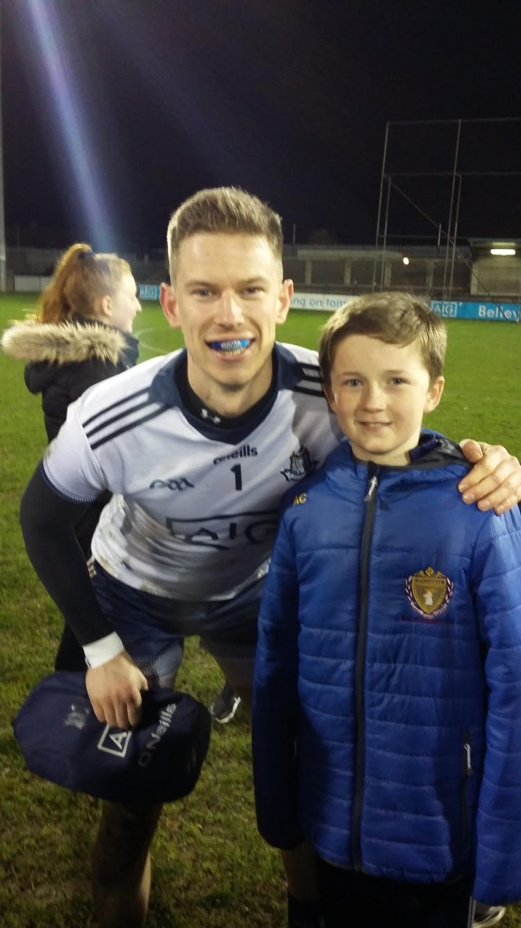 Andy Bunyan with juvenile player Alex Courtney after the game.