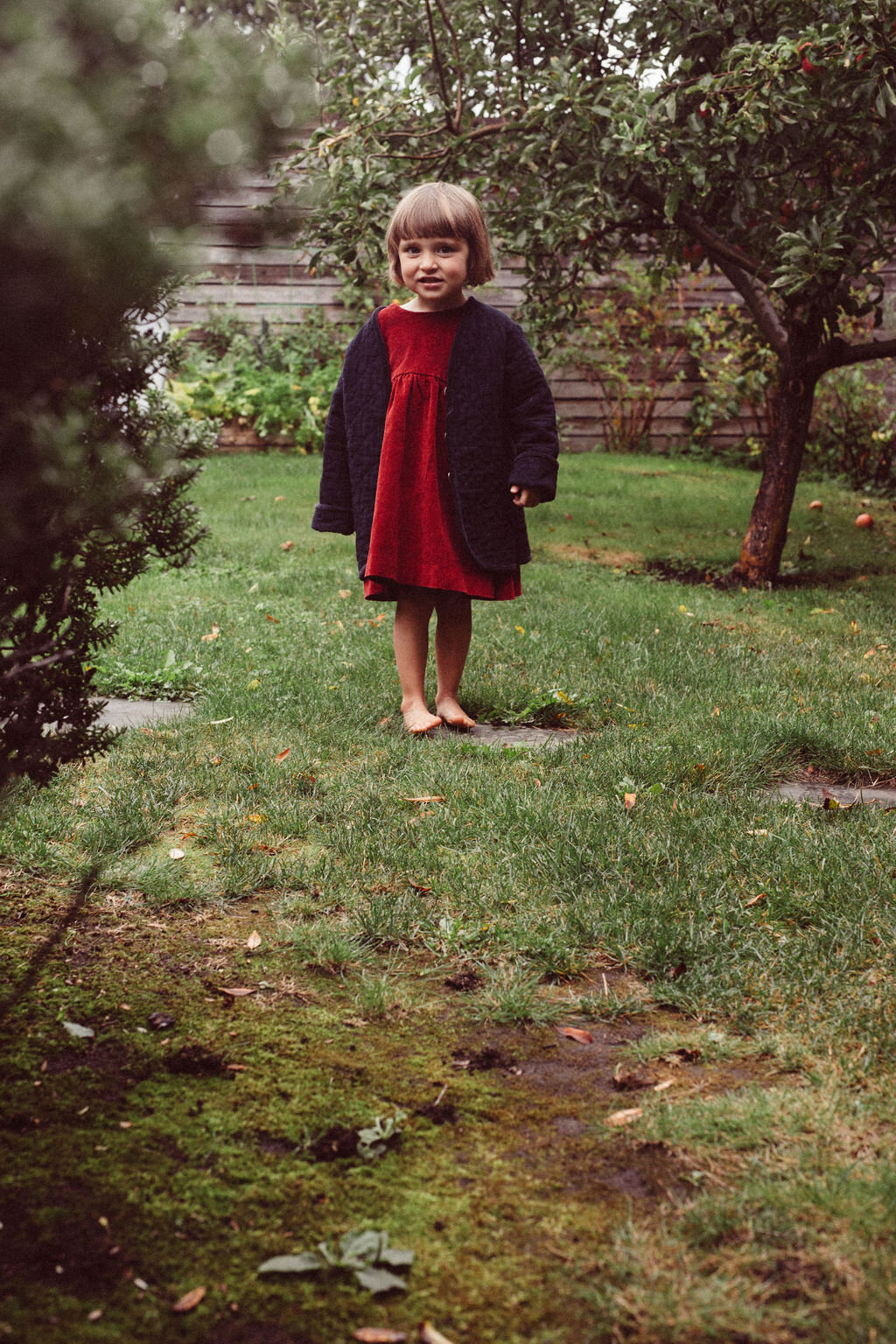 checking out the apple tree in our  kids sage jacket