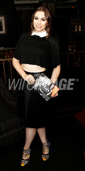 Sophie holding the catalog for her new collection