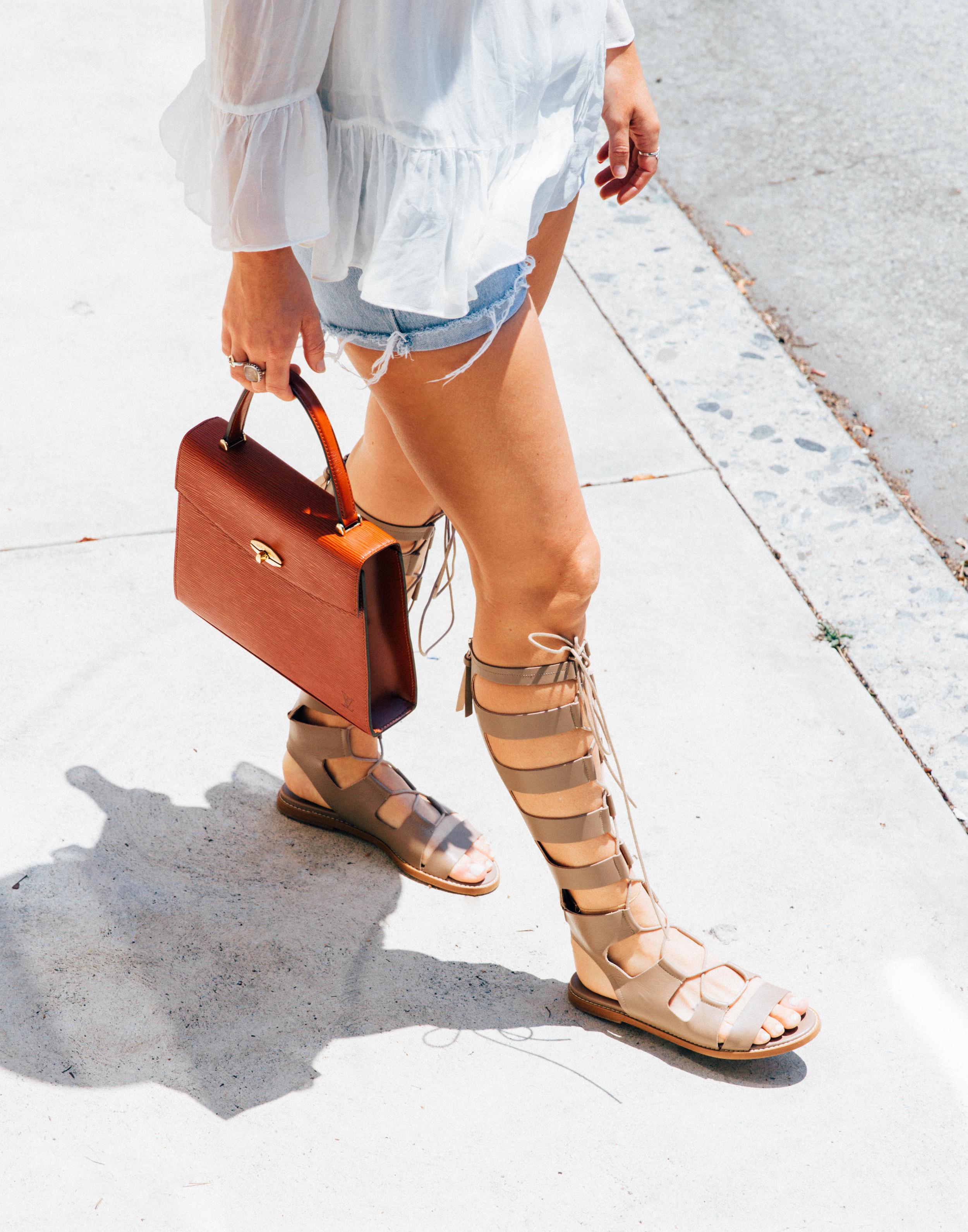 zara sandals gladiators louis vuitton bag detail