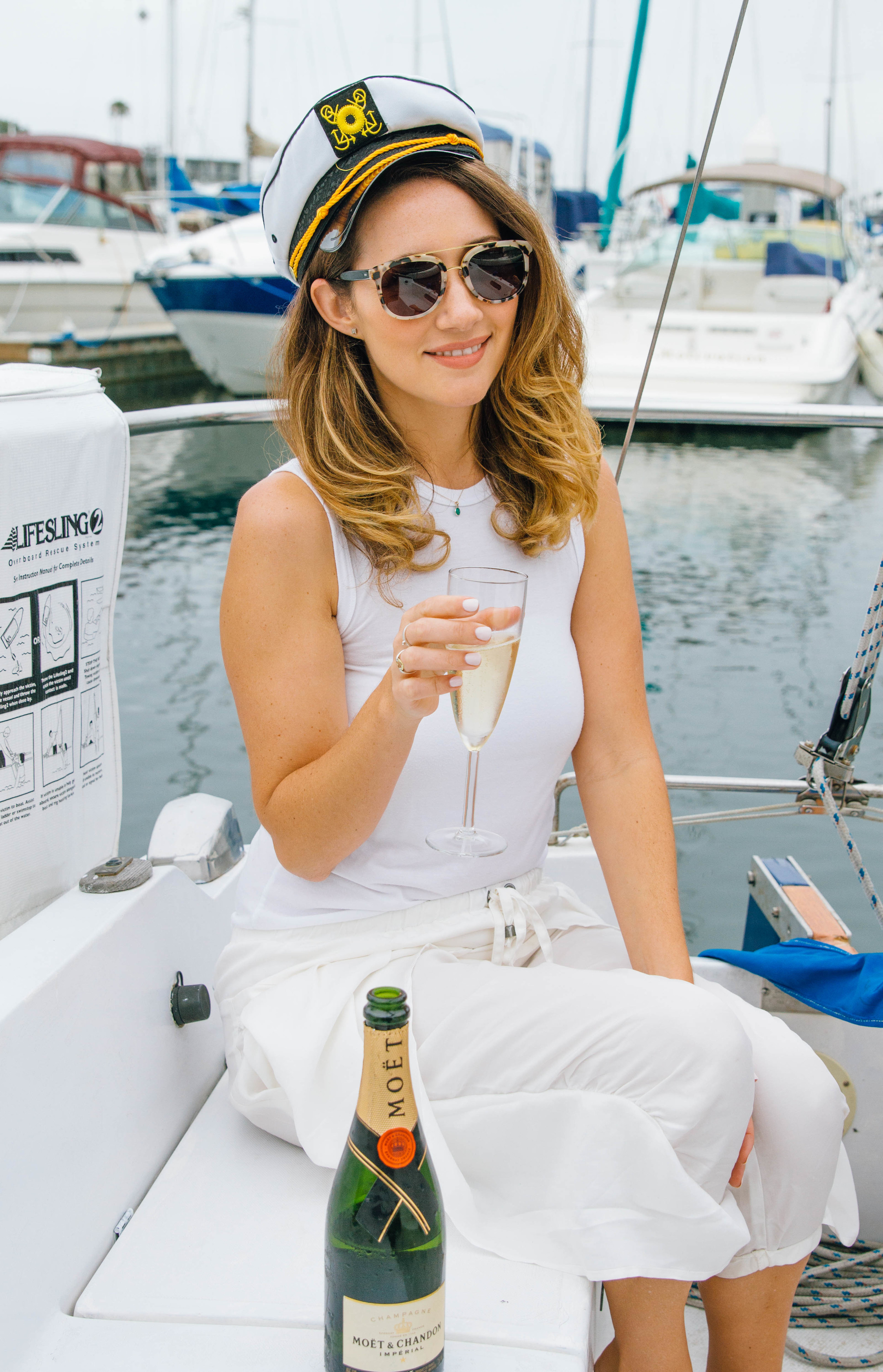July 4th Essentials:  Sunglasses,  Krewe Du Optic  and  Moet and Chandon