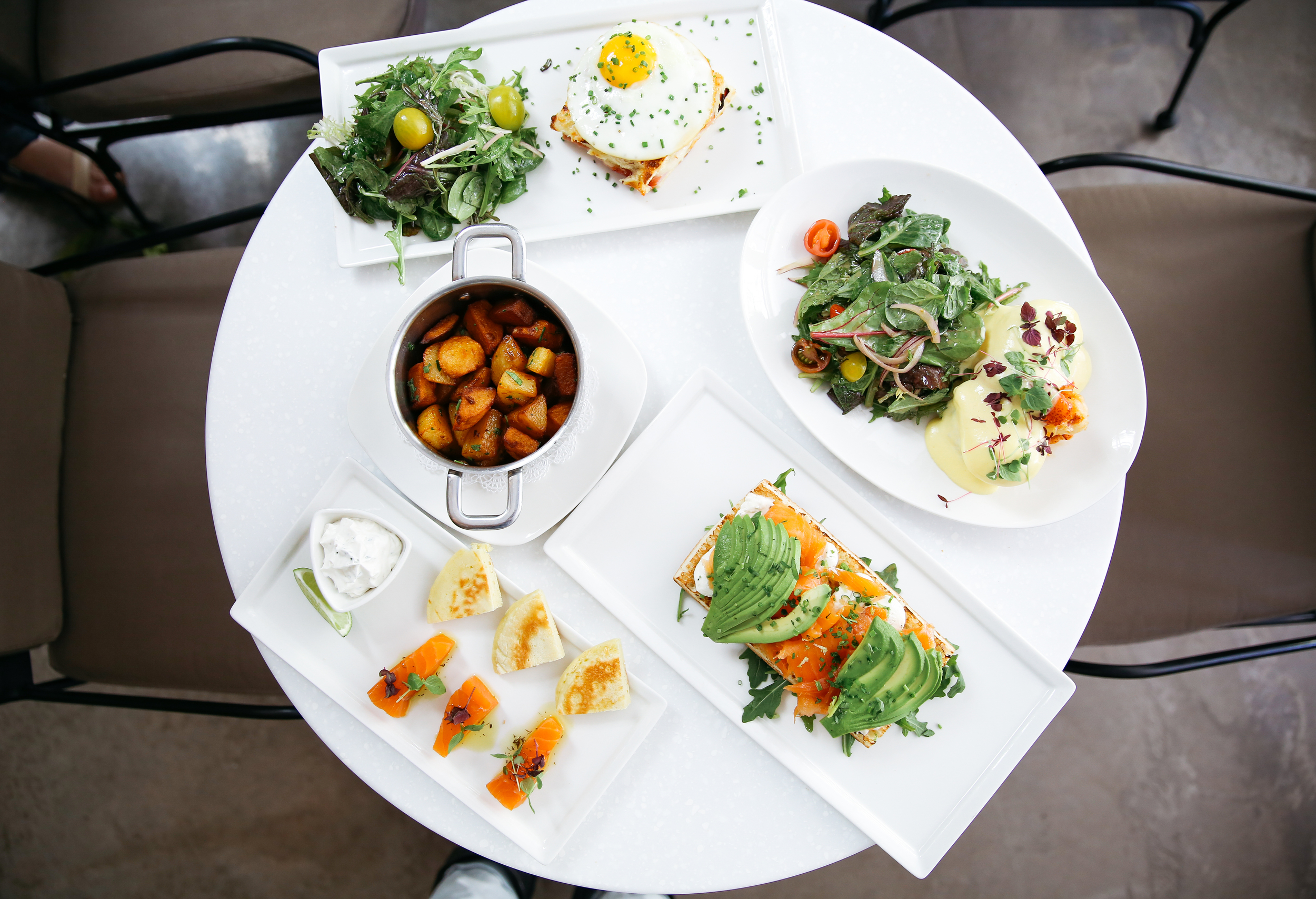 Some of the delicious brunch offerings at    Le Petit Pari  s . (From Top- Croque Madame, Lobster Eggs Benedict, Smoked Salmon Tartine, Salmon Gravlax, House Potatoes)
