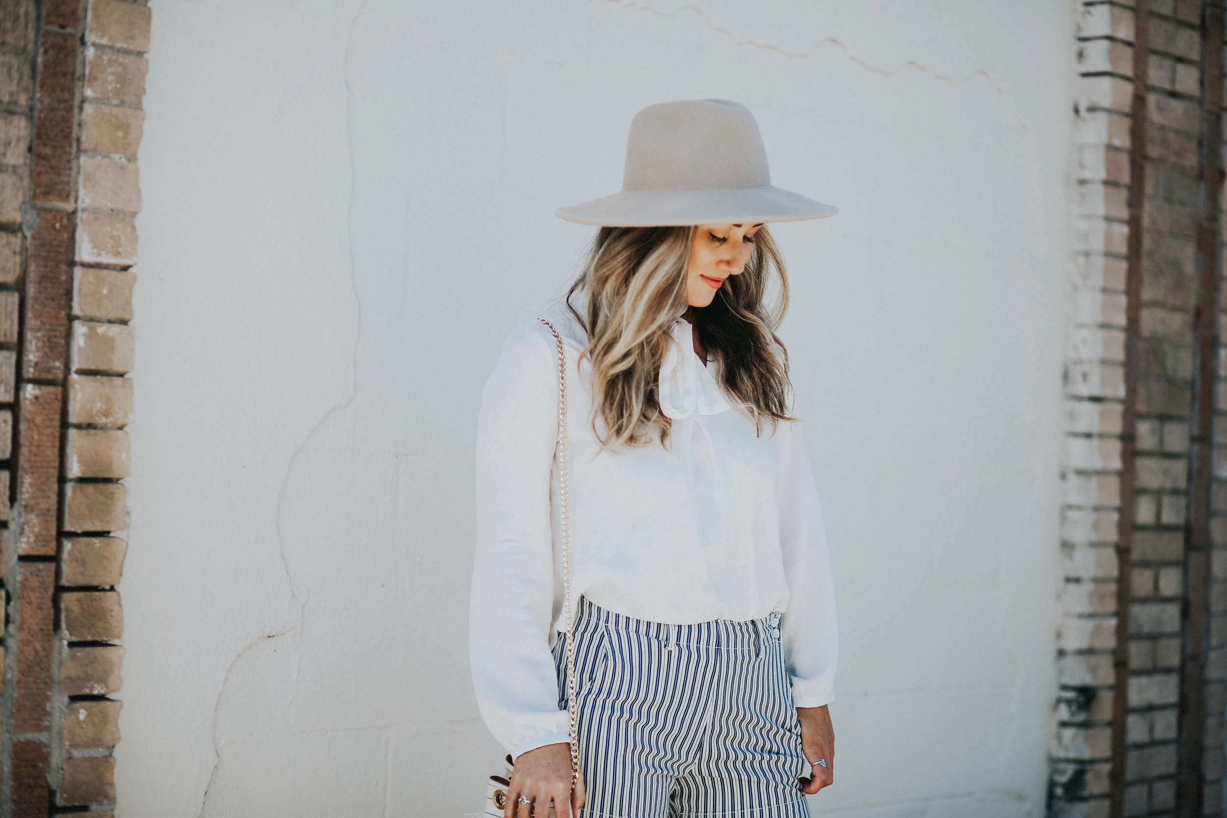 Blue and white shorts, white blouse, and street style via The Style Sauce blog