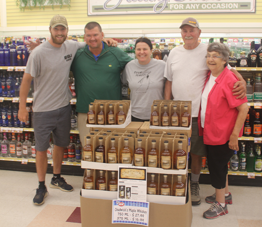 Forest Chadwick, Jack Goggin, Lynn Chadwick, Larry Chadwick, and Anne Chadwick with the very first display of Chadwick's Maple Craft Spirits at Goggin's IGA in Randolph, Maine.