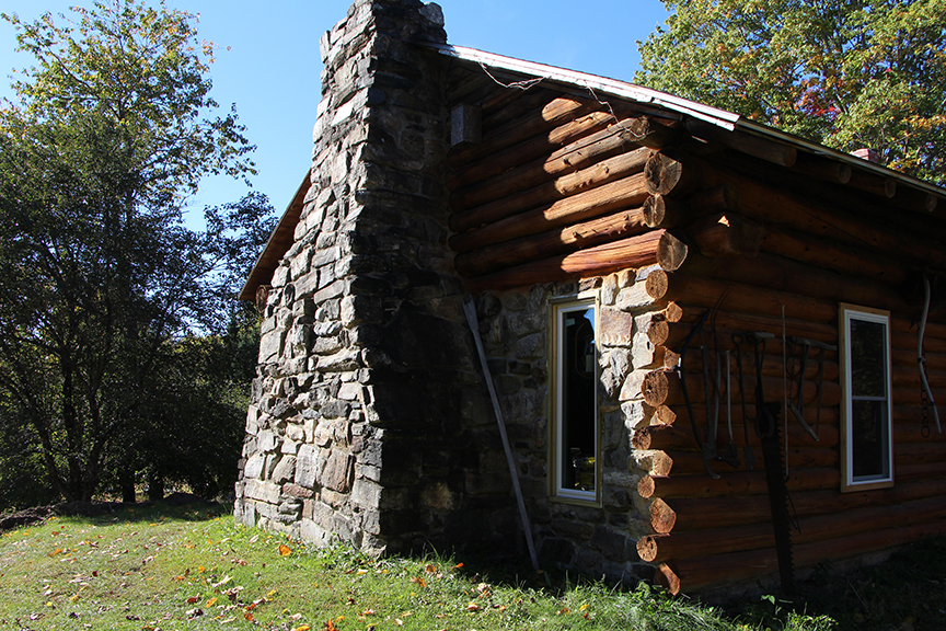 The Cabin.  Hand-built nearly 40 years ago now.  The rocks for that Chimney were all gathered from the property during the month long construction, and set by hand by Larry himself.