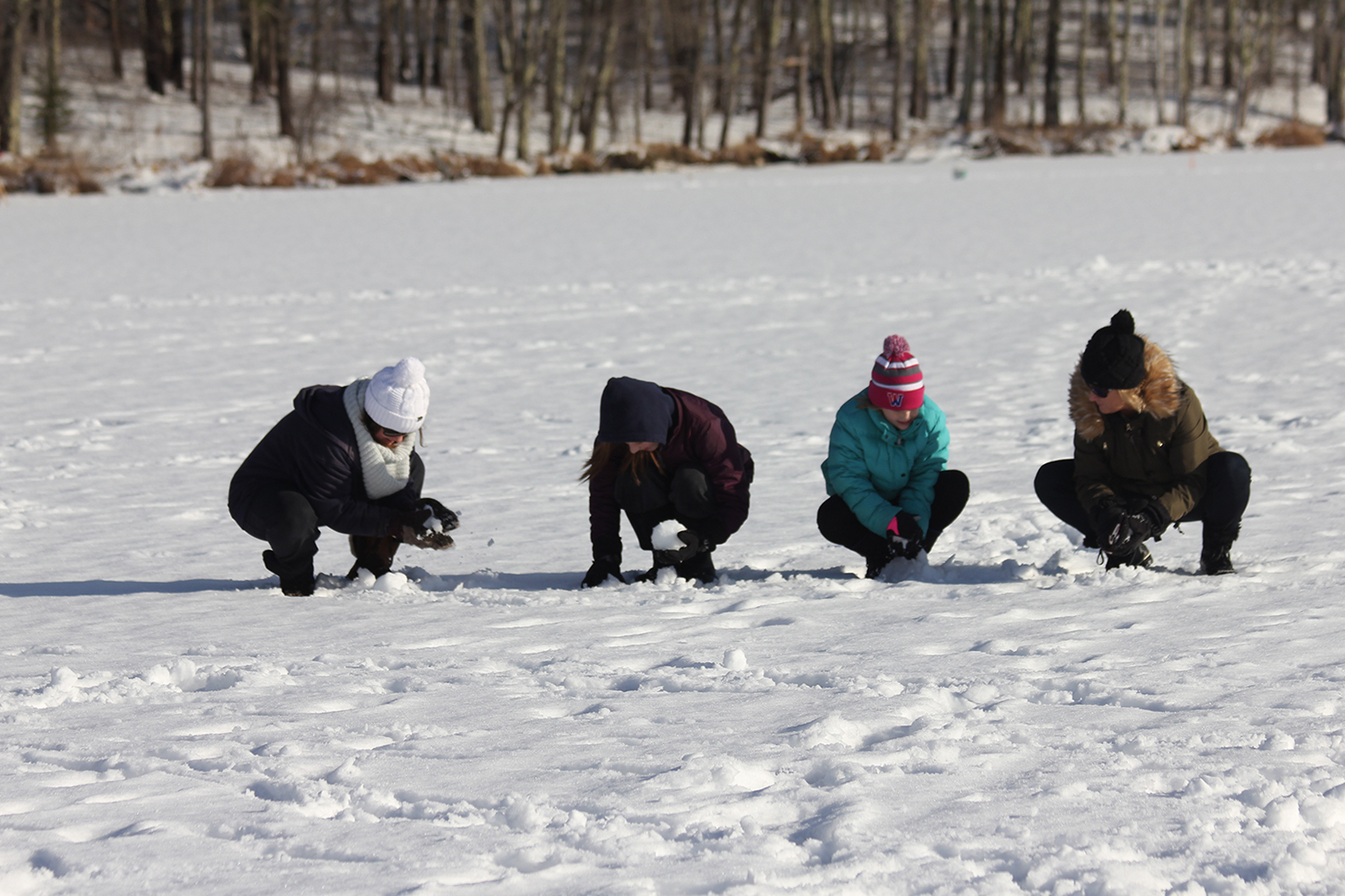 Actually, first things first: making snowballs in the middle of a frozen pond.