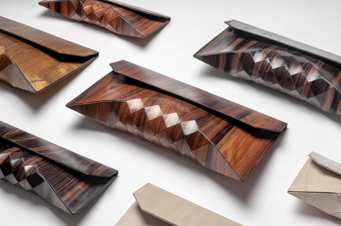 variety of wood finishesoffered on these gorgeousgeometric clutches by TESLER + MENDELOVITCH
