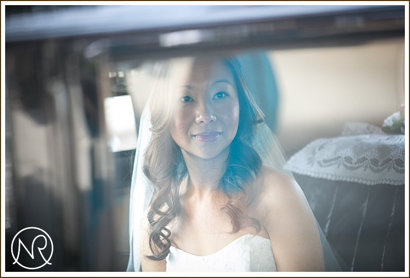 Beautiful bride looking out of car window