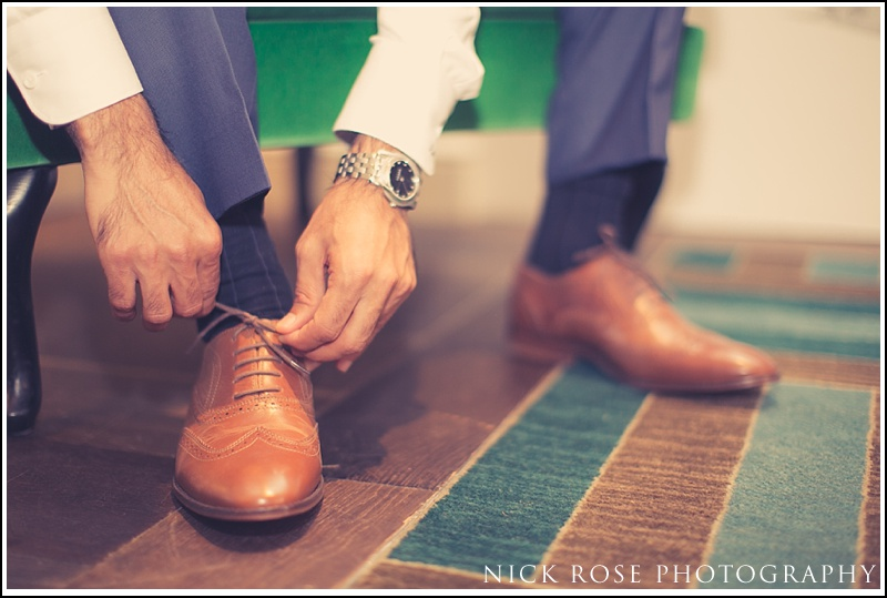 Groom preparation photography Kensington roof gardens