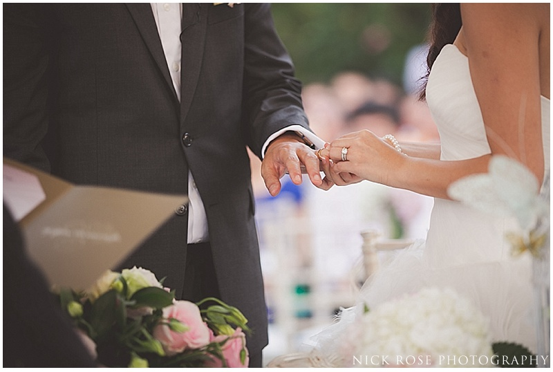 Bride and groom exchanging rings in Singapore