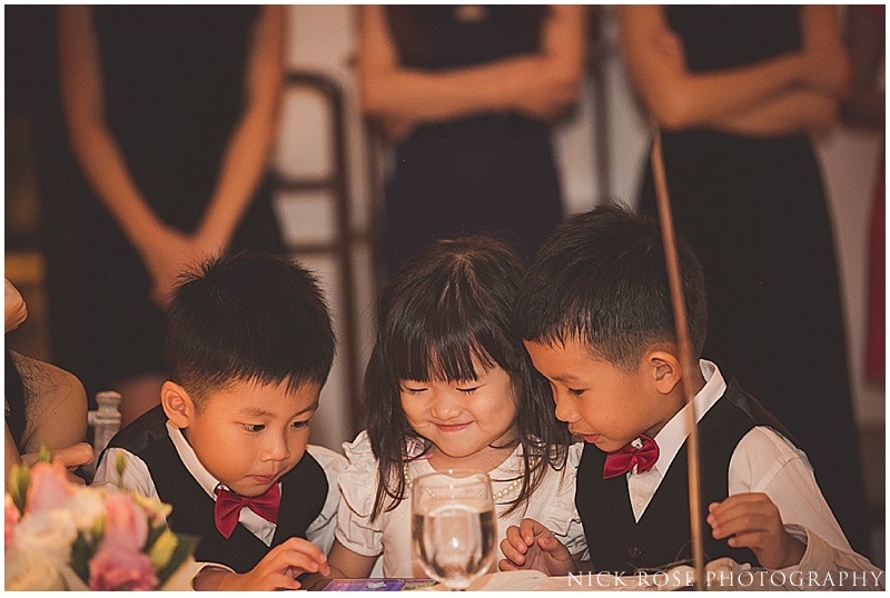 Children playing at a wedding in Asia