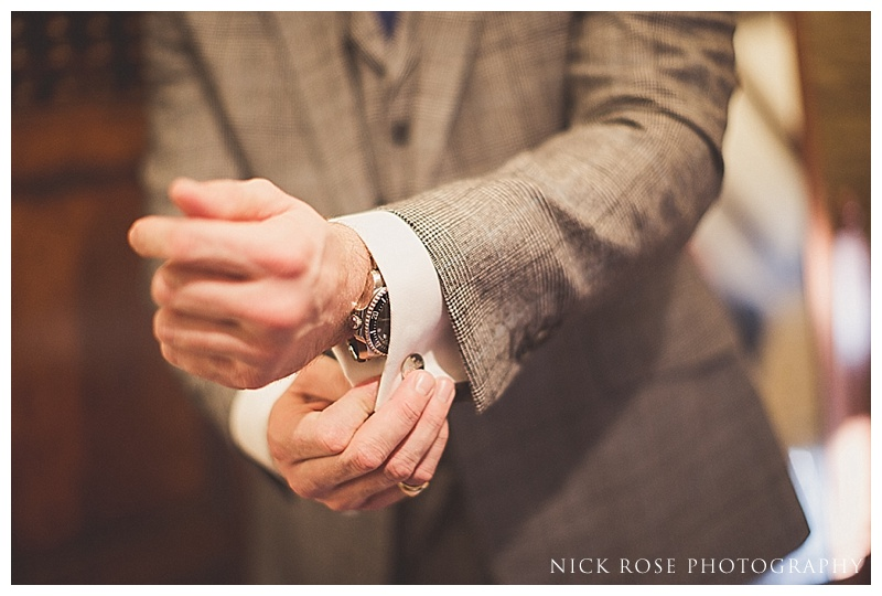 Groom adjusting cufflinks