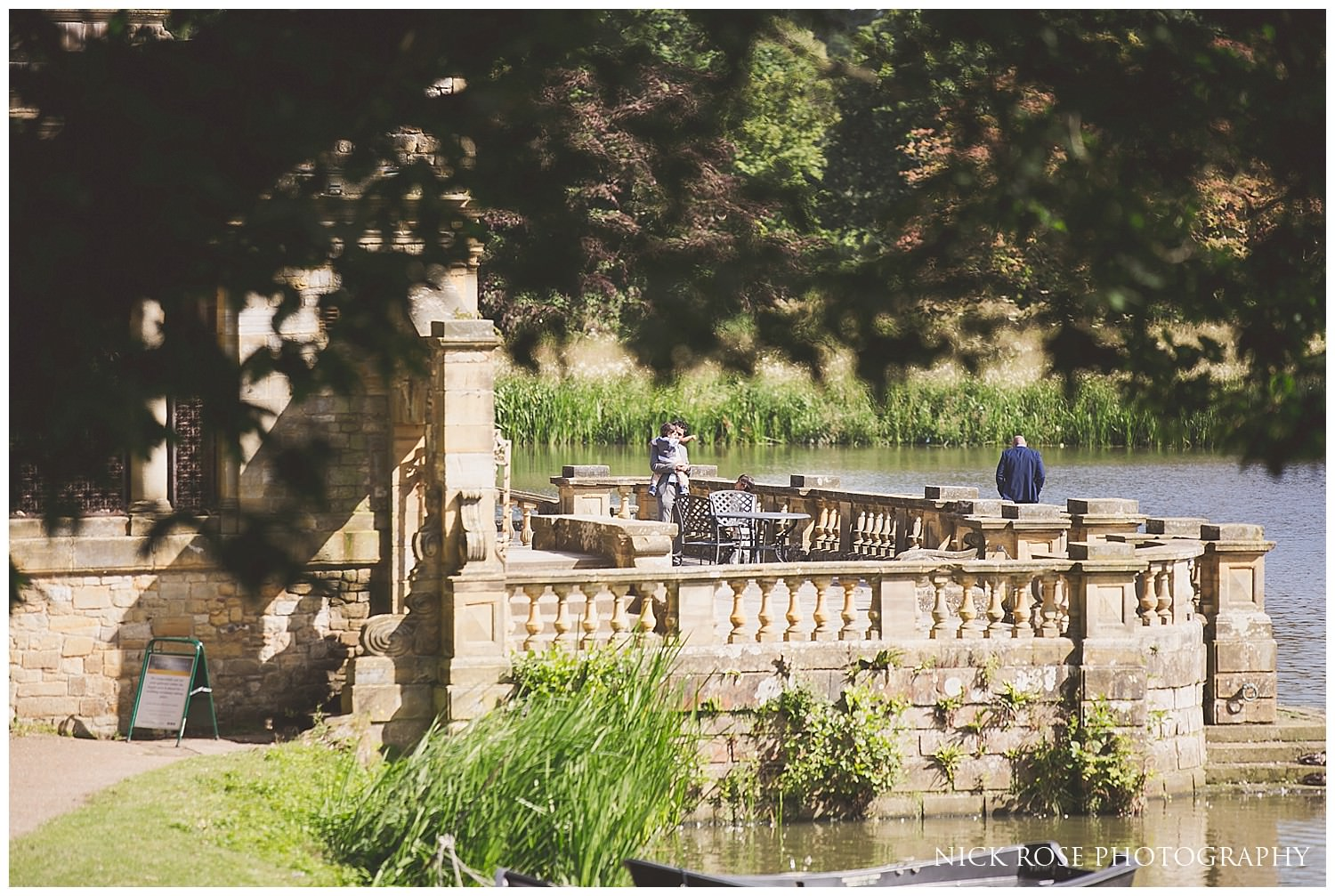 Outdoor summer wedding by the lake at Hever Castle in Kent
