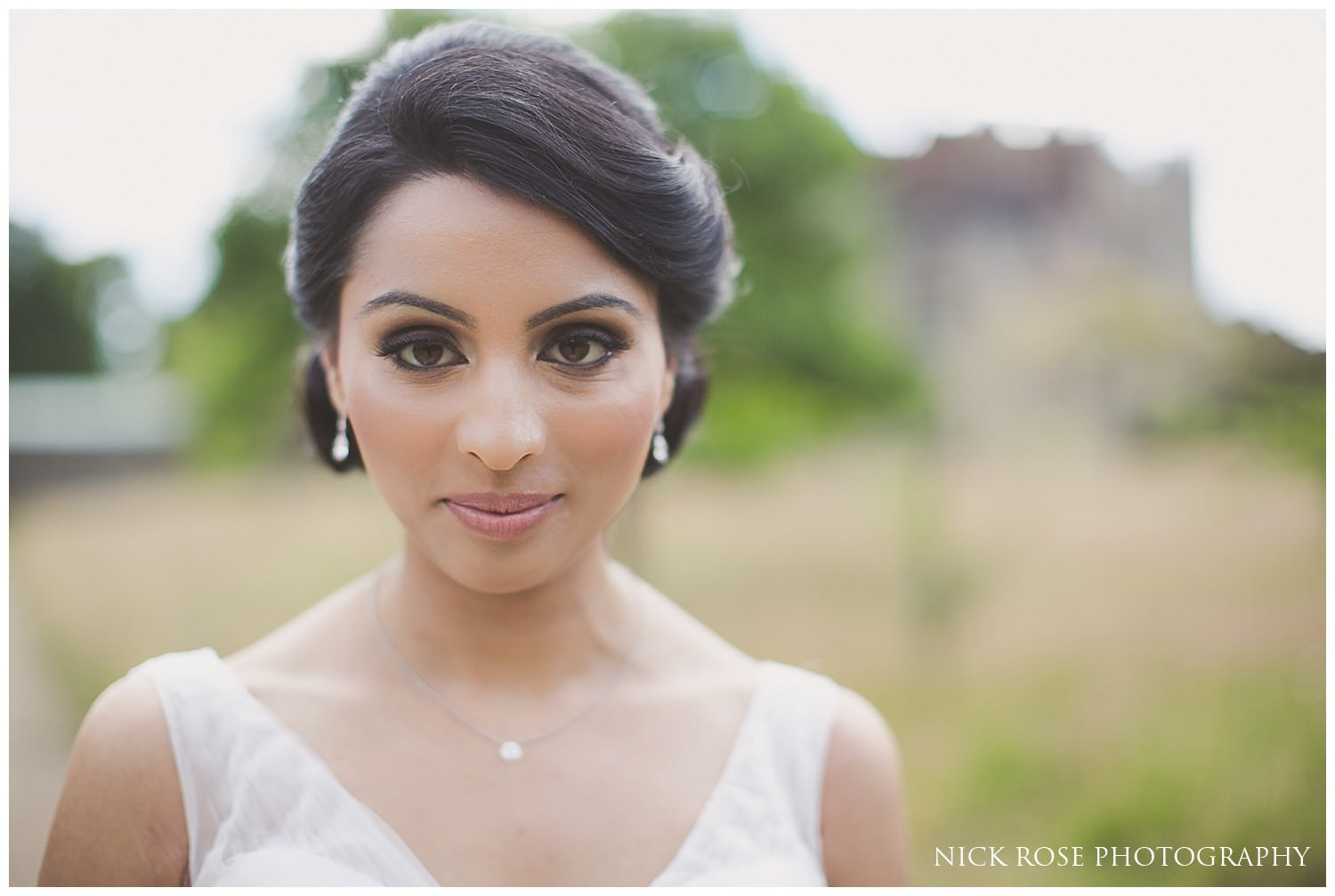 Bride looking at the camera before a Kent wedding at Hever Castle