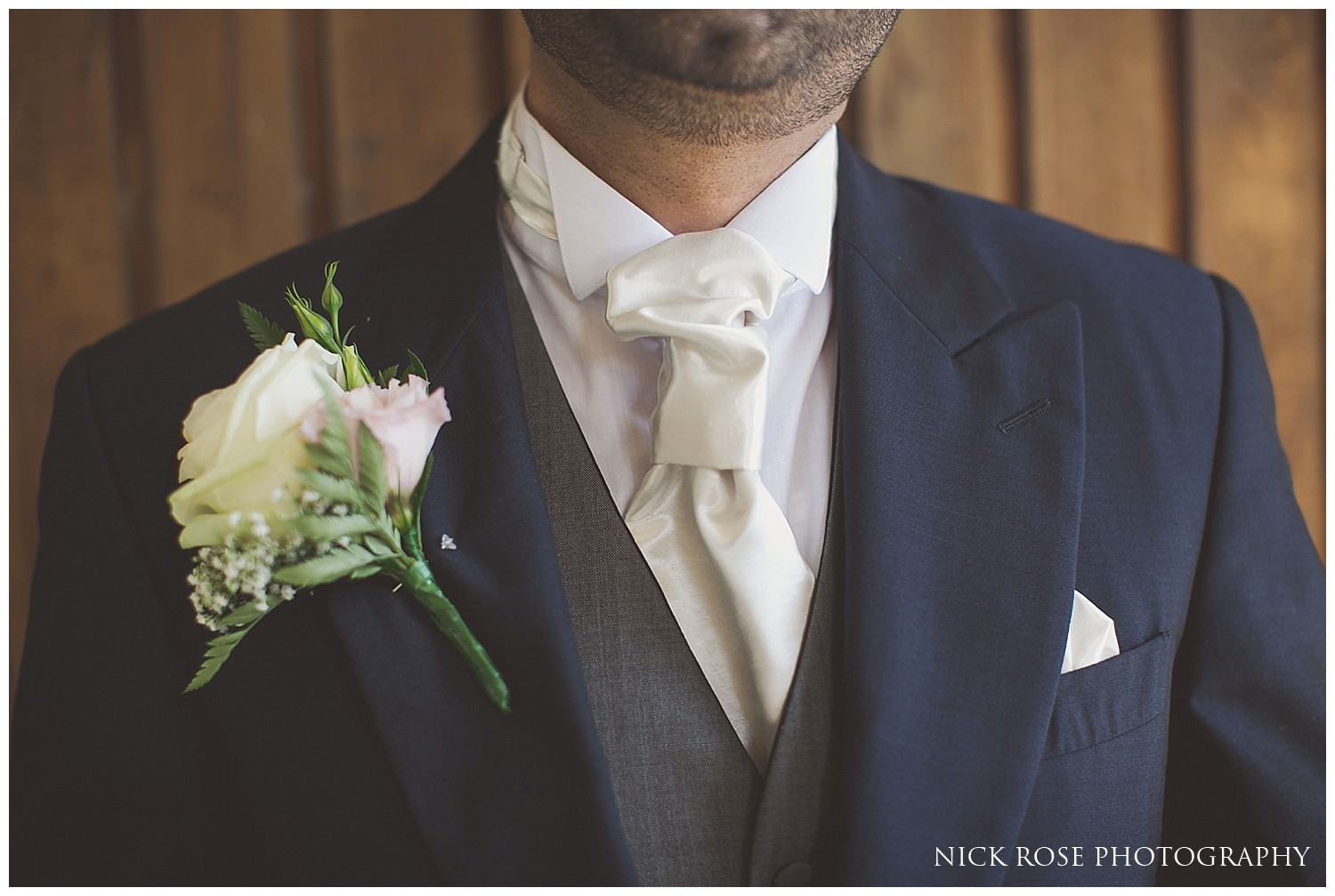 Groom with cream boutonniere getting ready for a Hever Castle wedding in Kent